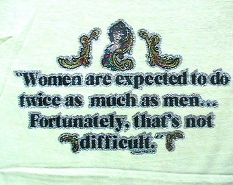 1970s  T.shirt - Women are expeted to do twice as much as men ... Fortunatly, that not difficult  - Dated 1979 - Made in the USA - NEW - M