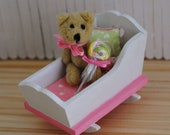 Miniature 1:12 Scale Pink And White Baby Cradle With Pink Bedding, Matching Pillows, And A Darling Teddy Bear Holding A Swirl Lollipop