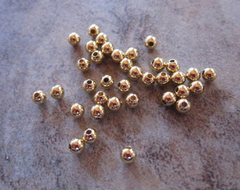 Bead Ends - Lot of 100, gold-plated brass, 3mm half-drilled round, for use with memory wire JD189