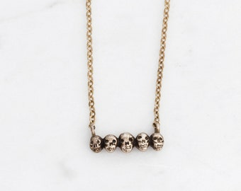 Tiny golden skull necklace