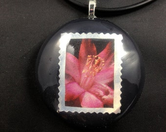 Pink Flower Stamp in Black Resin on a Black Rubber Cord