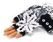 Fingerless gloves black & white white buttons  have a lace pattern, hand knit.