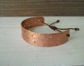Handmade hammered  cuff copper bracelet with brown cotton cord .