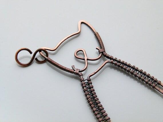 Copper wire wrapped cat pendant .