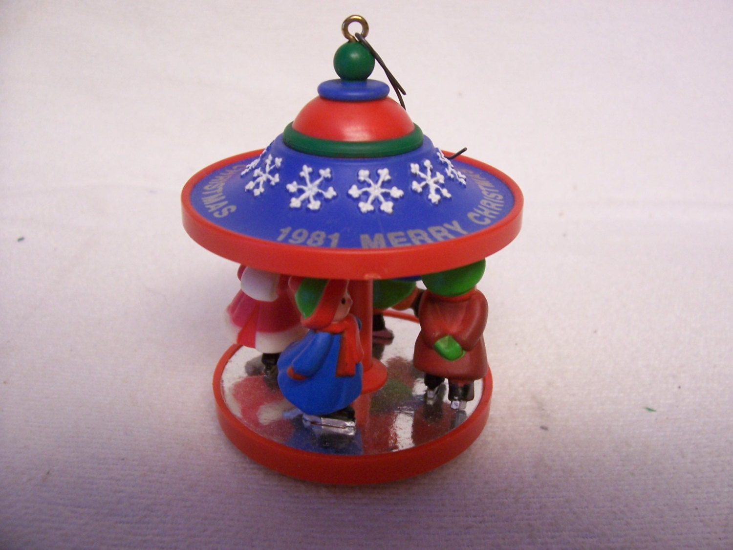 Hallmark Carousel Ornament Vintage Christmas Skaters Merry