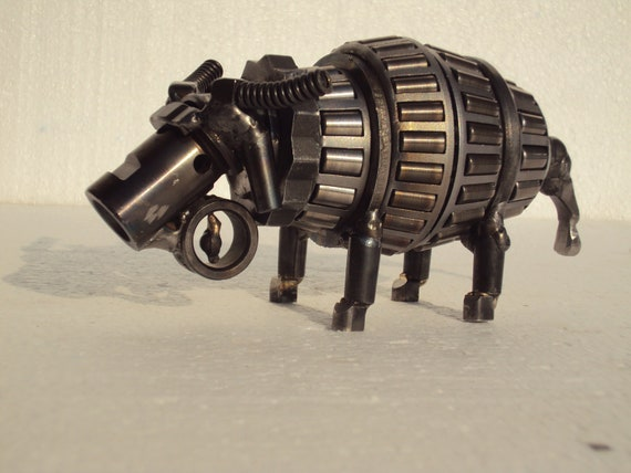 Water Buffalos, metal puzzle made from 12 pieces.