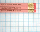 love is a great adventure engraved pencil set 3 in pastel pink.