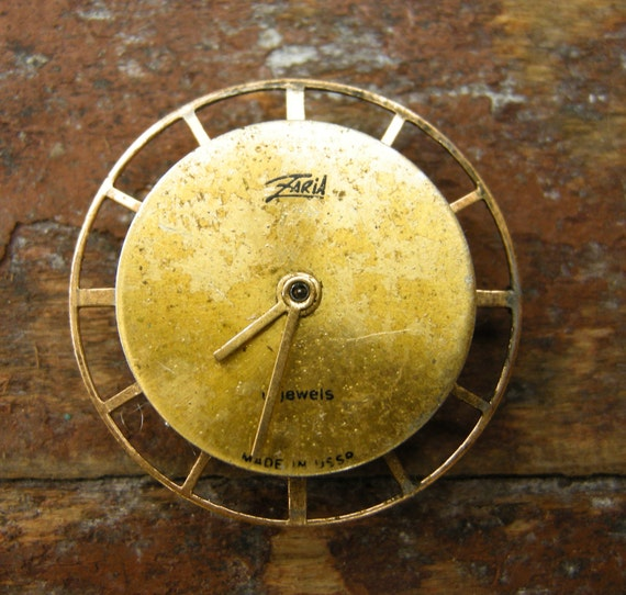Vintage small watch movement with dial.
