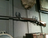 Over the mantle Shotgun riffle hangers. Made from horse shoes.