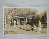 vintage sepia photograph of tennis ladies in a garden, australia