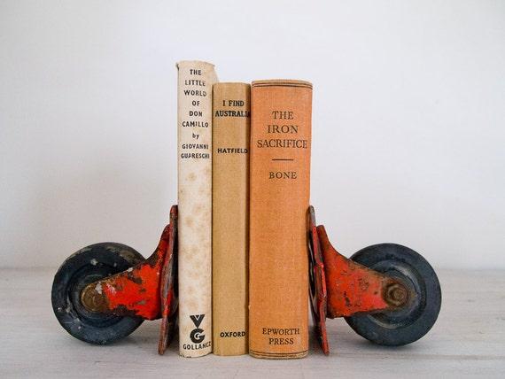 vintage industrial orange castor set/bookends