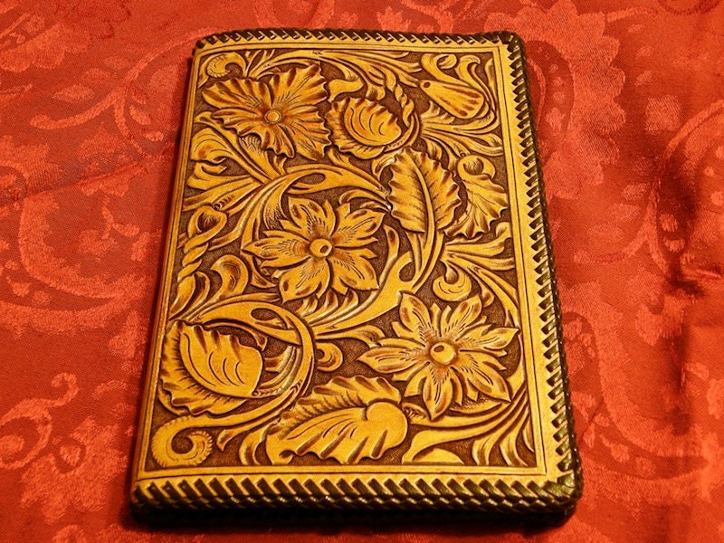 Northwest style carved leather notebook with shell stamp