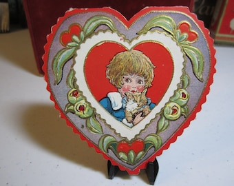 1920's-30s die cut embossed and gold gilded valentine card little girl with bobbed hair holding a kitty cat