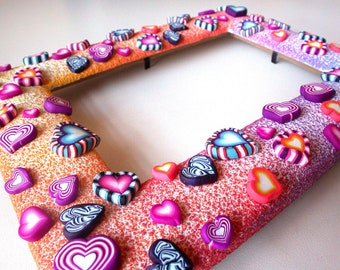 Polymer whimsical hearts. Picture frame.