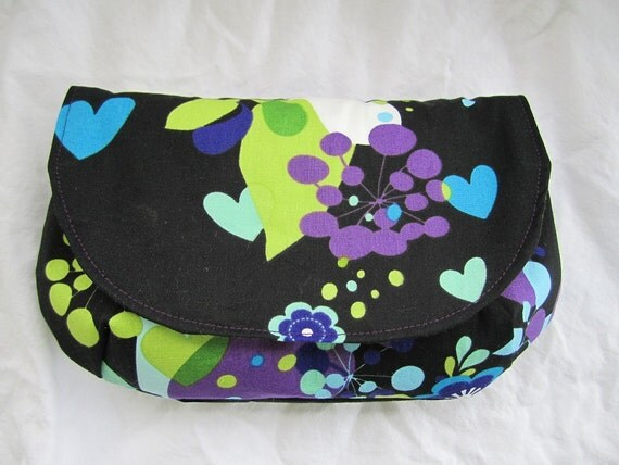 Black with purple, blue and green outside green and white polka dots inside summer clutch flap purse