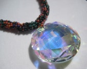 orange, purple, blue and green beaded necklace with crystal pendant