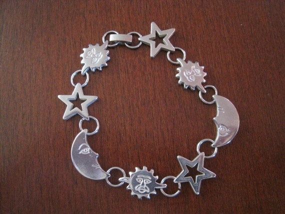Whimsical sterling silver, sun, moon and stars link bracelet