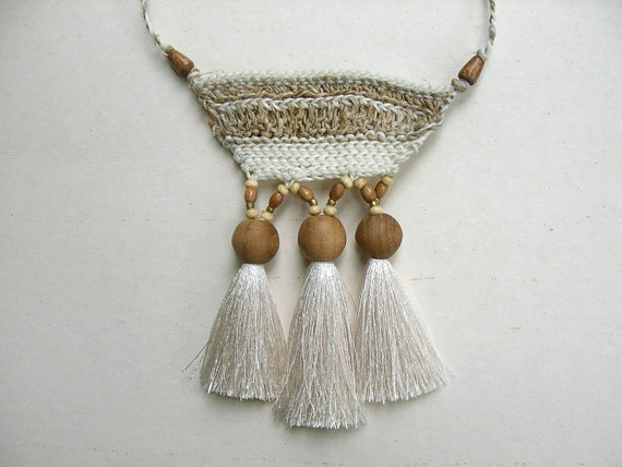 White Tribal  Necklace : Natural style hemp-waxed cord mixed with wooden bead, brass bell, cotton tuff