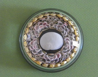 Seashell decorated paperweight