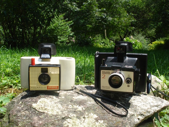 Pair of Vintage Polaroid Cameras: Swinger Model 20 and Square Shooter 2