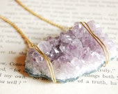Beautiful light. Large raw amethyst cluster necklace with gold chain details.