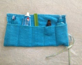 Travel Toiletry Roll in terry cloth for toothbrush, paste, and hair supplies