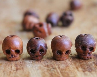 Tulua Carved Dark Wood Skull Beads (10) - Perfect for El Dia de Los Muertos Jewelry and Shrunken Head Coolness