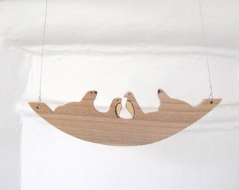 Necklace natural wooden handcarved seals and penguins on ice in wood by bois et rois handmade handcraft