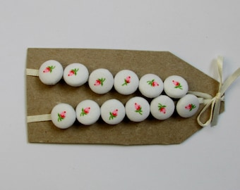tiny (1/2 in) covered buttons with pink and green rosebuds on white