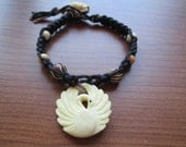 Hemp Bracelet, Carved Swan Bone charm beads black & brown hemp beaded bracelet