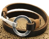 FREE SHIPPING..Hand made brown leather  men's bracelet. The brown leather around your wirst twice. Hammered metal work ring and hook.