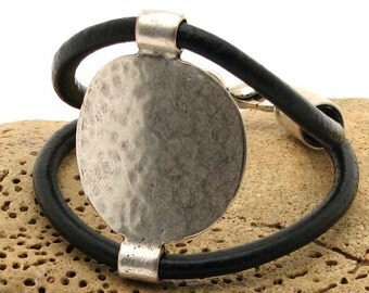EXPRESS SHIPPING Women's leather bracelet. Costume , bangle black leather bracelet with silver plated textured disc medallion and clasp.