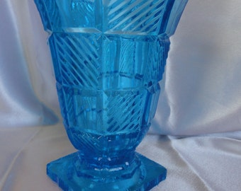 Very heavy thick glass vase in the color of the Caribbean sea, aqua, turquoise blue