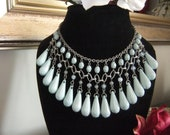 Beautiful vintage seafoam aqua eygptian style lucite bib necklace.