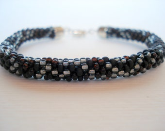 Hand crochet bracelet out of black and silver beads