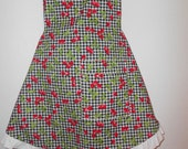 Women's sexy cherry apron with white ruffle trim.