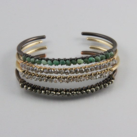 Bronze or blackened copper cuff with solid row of sparkling gemstones
