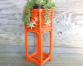 plant stand / orange / tall wicker planter