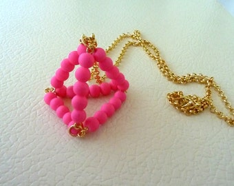 Neon pink pyramid necklace