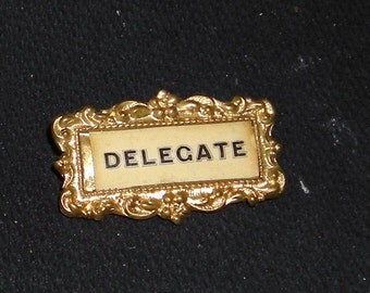Vintage.... Delegate Pin...Goldtone ....Vintage ...Ornate Goldtone Frame ...Black Lettering on Metal... Victorian