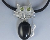 Black Cat necklace, made of Solid Sterling Silver, Black Onyx, and Peridot eyes.