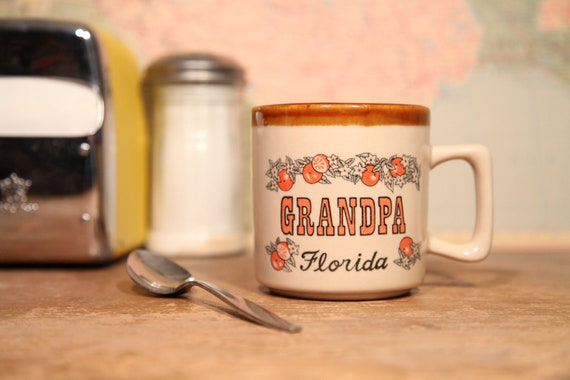 "Fly-Ass Mug say ""Grandpa - Florida"" with some oranges on it"