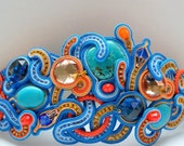 SOutache cuff with turquoise flat crystals orange blue deep colour