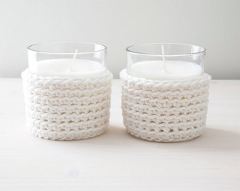 Set of two candles with white or grey crocheted cover
