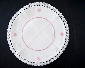 Beautiful and delicate white and pink handmade crochet doily