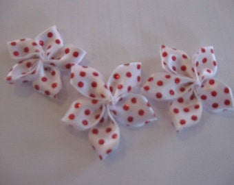 White Satin Ribbon wtih Red Glitter Dots Folded Into Flowers