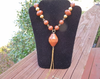 Vintage Gold Tone Necklace with Brown Beads and Tassles.