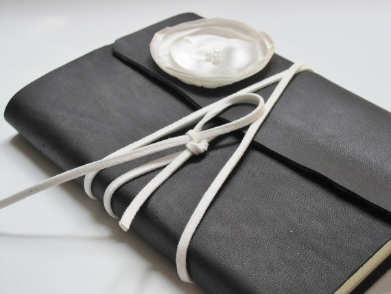 medium black leather journal with soft white wrap closure and flower embellishment