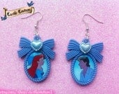 The Little Mermaid Ariel and Eric bow cameo earrings on blue settings including pearl love hearts