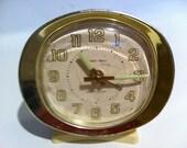 Small cream and gold Baby Ben Westclox clock.  Desk clock.  Winds.  Works.